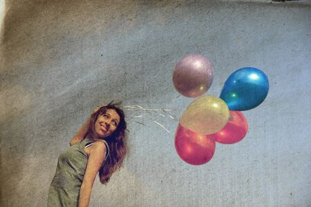 Young woman with colorful balloons. Photo in old image style. photo