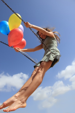 Young woman on a swing photo