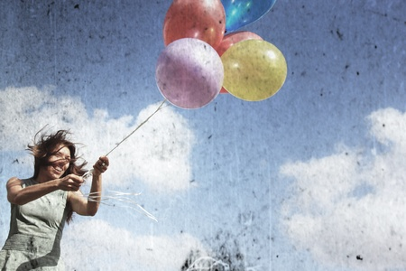 Young woman with colorful balloons  Photo in old image style  photo