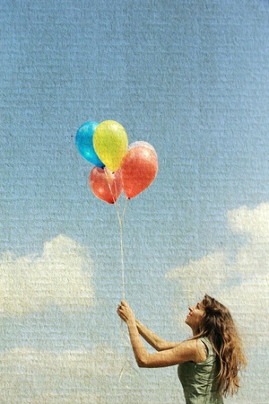 flying hair: Young woman with colorful balloons  Photo in old image style  Stock Photo