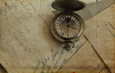 antique pocket watches and old letters photo