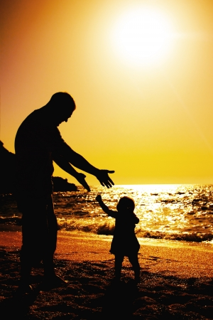 father and daughter playing on the beach at sunset Stock Photo - 13877507