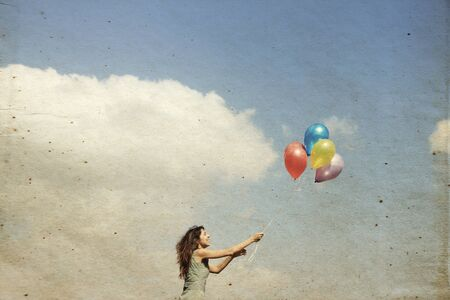 Young woman with colorful balloons photo