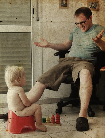 Child on potty play with father. Photo in old image style. photo