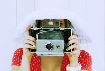 girl with an old camera  photo