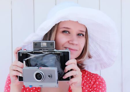 girl with old camera photo