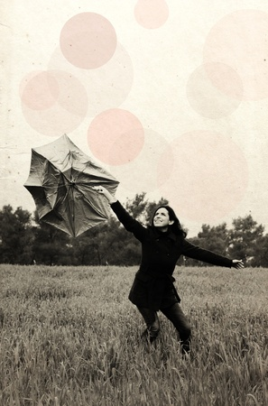 Young woman with umbrella. Photo in old color image style. photo