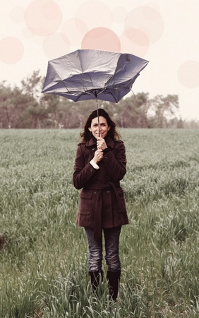 Young woman with umbrella  Photo in old color image style  photo