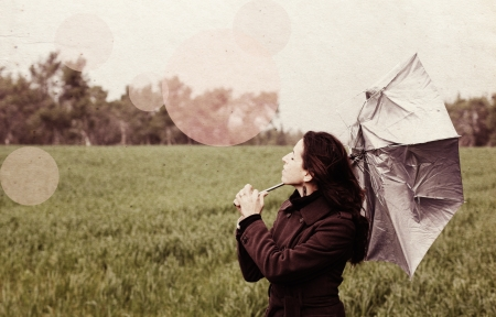 Young woman with umbrella in old color image style Stock Photo - 14485964