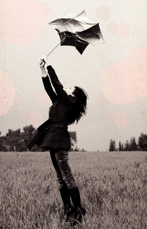 Young woman with umbrella in old color image style  photo