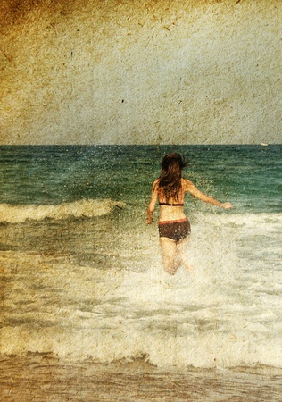 young girl at the sea  Photo in old color image style photo