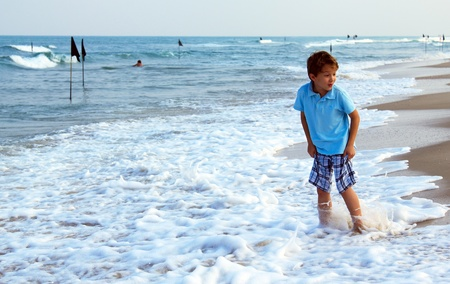 7 years old kid coming to the water's edge