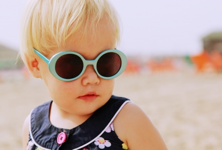 Portrait of cute 1,5 years old baby with fashion vintage sunglasses photo