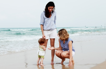 daughter in law: two beautiful girls with a baby on the beach