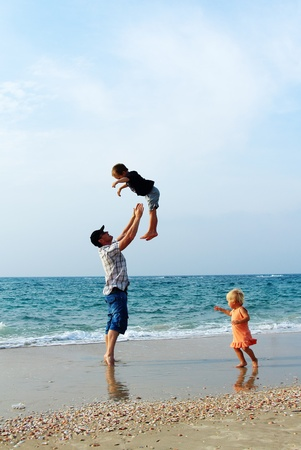 father with two kids on vacation at sea Stock Photo - 16139201