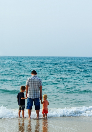 father with two kids on vacation at sea Stock Photo - 16139210