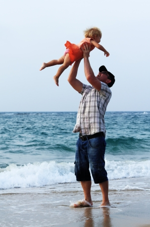 father and daughter on vacation at sea photo