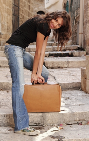 beautiful girl with vintage suitcase photo