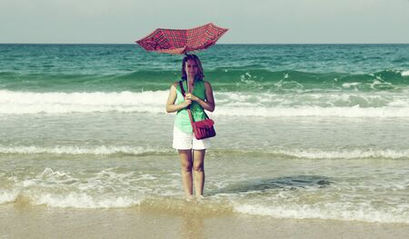 woman with umbrella.  Retro colors. photo