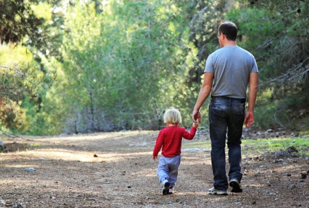 father and daughter in the spring forest