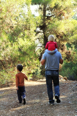 Father with two kids outdoors photo