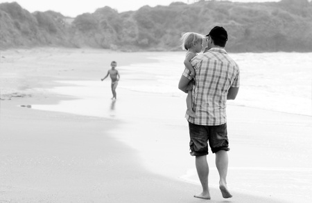father with two kids on vacation at sea on sunset colours Stock Photo - 17081726