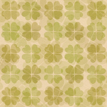 Textured paper with green clover pattern photo