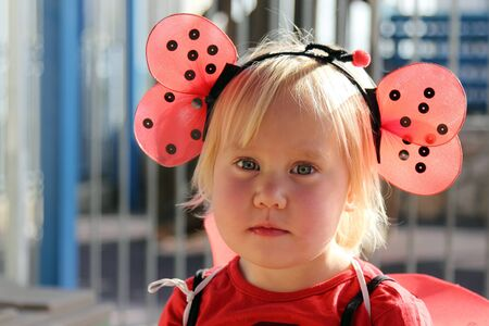 cute 2 years old girl dressed as a ladybug photo