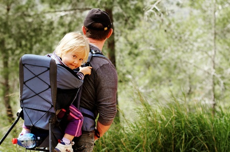 Father hiking with kid on backpack Stock Photo - 18206656
