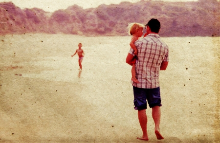 father with two kids on vacation at sea on sunset colours Stock Photo - 18206686
