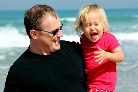 Portrait of father and daughter on the beach photo