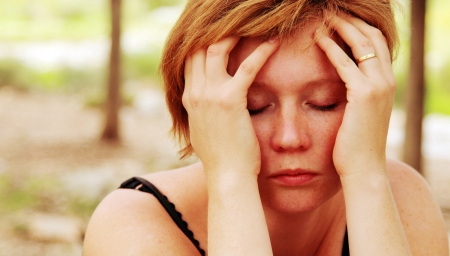 Close up portrait of sad redheaded woman Stock Photo
