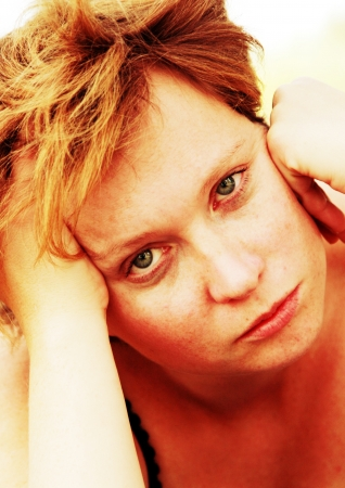 Close up portrait of sad redheaded woman photo