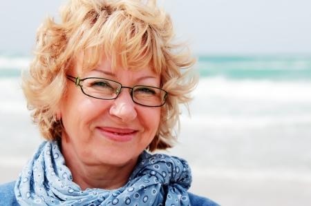 Portrait of happy senior woman at sea