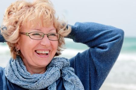 european expression face: Portrait of happy senior woman at sea
