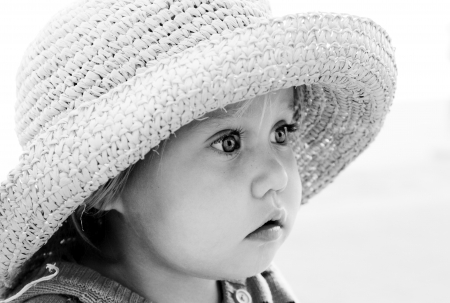 portrait of cute girl in a hat photo