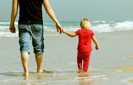 father and daughter on the beach Stock Photo - 19347810
