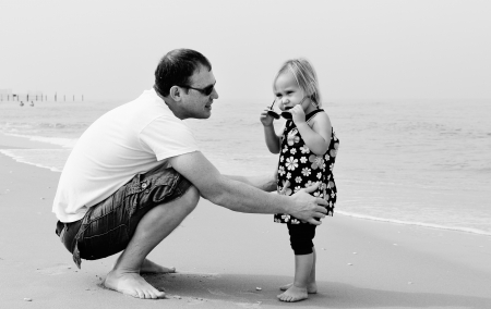 Happy father and his adorable little daughter photo