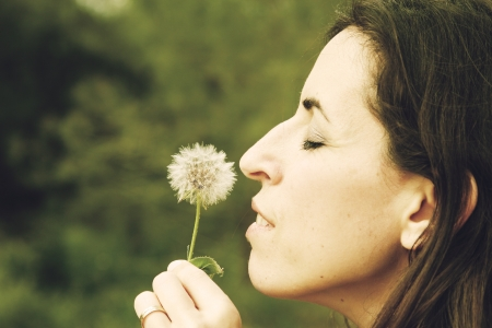portrait young woman with dandelion photo