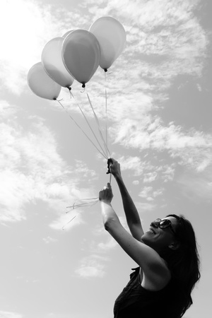 woman with red balloons photo