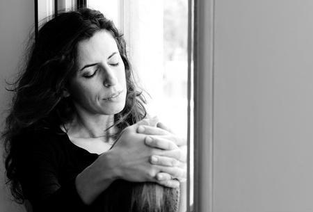 Portrait of beautiful woman sitting on the window Stock Photo - 19336434