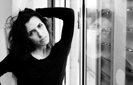 Portrait of beautiful woman near the window Stock Photo - 19336464
