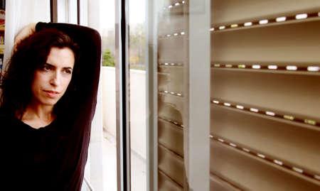 Portrait of beautiful woman near the window Stock Photo - 19336490