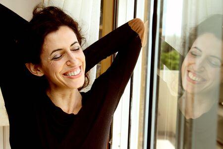 Portrait of beautiful woman near the window photo