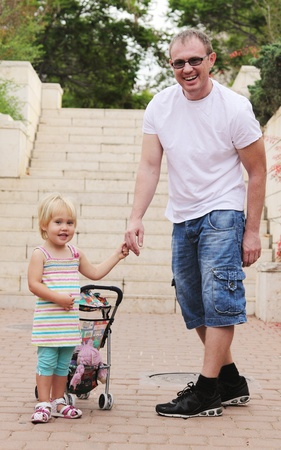 happy father with adorable girl outdoor photo