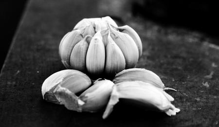 garlic on rough chopping board Stock Photo - 19987620