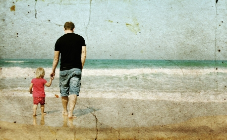 family fun day: father and daughter on the beach