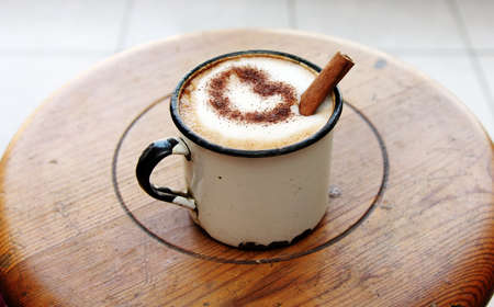 cup of coffee with cinnamon photo