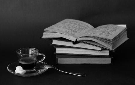 cup of coffee on vintage books photo