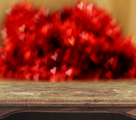 Vintage wooden table with heart bokeh background photo